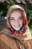 Beauty woman in the national patterned scarf Royalty Free Stock Images