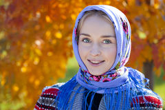 Beauty woman in the national patterned scarf Stock Image