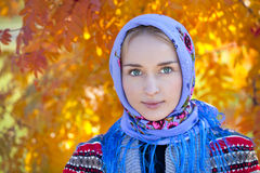 Beauty woman in the national patterned scarf Stock Images