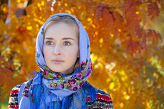 Beauty woman in the national patterned scarf Stock Photo