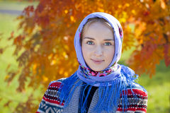 Beauty woman in the national patterned scarf Royalty Free Stock Photography