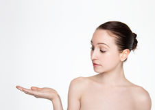 Beauty woman natural makeup holding arm up for text. On white background Stock Image