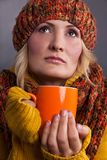 Beauty woman with an orange-colored cup Stock Photo