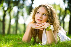 Beauty woman outdoor lie Stock Images