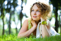 Beauty woman outdoor lie Royalty Free Stock Photos