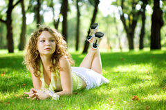 Beauty woman outdoor lie Stock Image