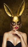 Beauty woman over gold background Stock Photos