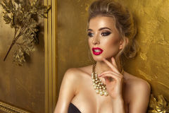 Beauty woman over gold background Royalty Free Stock Images