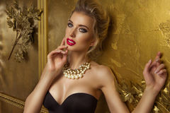 Beauty woman over gold background Royalty Free Stock Photography