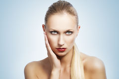 Beauty woman over white. She has Royalty Free Stock Image