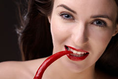 Beauty woman with pepper Stock Photo