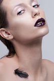 Beauty Woman with Perfect Makeup. Beautiful Professional Holiday Make-up. Purple Lips and Nails. Beauty Girl's Face Stock Image