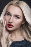 Beauty Woman with Perfect Makeup. Beautiful Professional Holiday Make-up. Red Lips and Nails. Beauty Girl`s Face isolated on Black Royalty Free Stock Photo