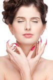 Beauty woman with perfect skin and red nail Stock Image