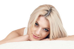 Beauty Woman on pillow. Young and beautiful woman on pillow with white background Stock Images