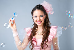Beauty woman in pink dress Royalty Free Stock Image