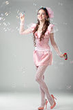 Beauty woman in pink dress stock images
