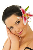 Beauty woman with pink lily in hair Stock Photos