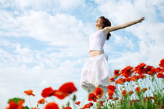 Beauty woman in poppy field Royalty Free Stock Photos