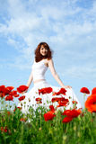 Beauty woman in poppy field Stock Photo