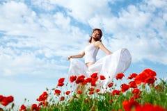 Beauty woman in poppy field Stock Image