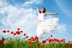 Beauty woman in poppy field Royalty Free Stock Photo