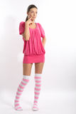 Beauty woman portrait. In strip pink knee-length socks on gray background royalty free stock images