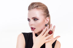 Beauty woman portrait. Beautiful model girl with perfect fresh clean skin and dark evening professional makeup wearing. Fashion jewelry. Blonde female showing Stock Photo