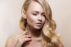 Beauty Woman Portrait. Beautiful Spa Girl Perfect Fresh Skin. Youth and Skin Care Concept. Beige background Royalty Free Stock Photos