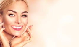 Beauty woman portrait. Beautiful spa girl touching her face. And smiling. Perfect fresh skin Royalty Free Stock Photo