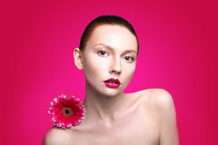 Beauty woman portrait bright backround holding. Gerbera flower Stock Image