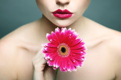 Beauty woman portrait bright backround holding. Gerbera flower Royalty Free Stock Photos
