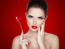 Beauty Woman Portrait. Professional Makeup for Brunette with Red Royalty Free Stock Photo