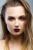 Beauty Woman Portrait. Professional Makeup for Brunette. Red Lipstick, Smoky Eyes. Beautiful Fashion Model Girl. Perfect Skin. Make up. Isolated on a Grey Royalty Free Stock Photo