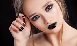 Beauty Woman Portrait. Professional Makeup and Manicure with smokey eyes. Black colors. Copy-space stock images