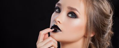 Beauty Woman Portrait. Professional Makeup and Manicure with smokey eyes. Black colors. Copy-space stock image