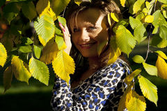 Beauty woman portrait under wutumn tree Royalty Free Stock Images