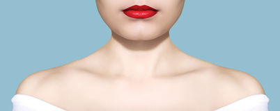 Beauty woman portrait white skin and red lips closeup over blue background studio Stock Images