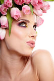 Beauty woman portrait with wreath from flowers on head over whit Stock Image