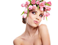 Beauty woman portrait with wreath from flowers on head over whit Stock Images