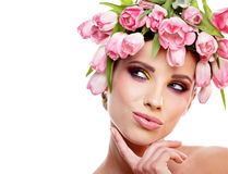 Beauty woman portrait with wreath from flowers on head over whit Stock Photos