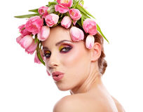 Beauty woman portrait with wreath from flowers on head over whit Stock Photo