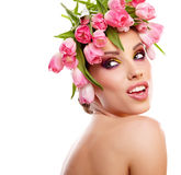 Beauty woman portrait with wreath from flowers on head over whit Stock Photography