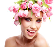 Beauty woman portrait with wreath from flowers on head over whit Royalty Free Stock Photography