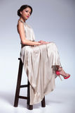 Beauty woman posing on a chair Stock Photography