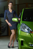 Beauty woman posing near fancy green color car Stock Photo