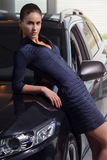 Beauty woman posing next to her car royalty free stock photo