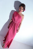 Beauty woman posing in pink dress Royalty Free Stock Photo
