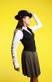 Beauty woman posing school-girl with hat Royalty Free Stock Photos