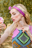 Beauty woman primping in park, lifestyle, people. Beauty portrait stylish playful woman primping with mirror in park, people, outdoors. Attractive hipster happy stock photo